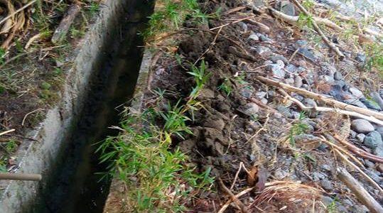 豪雨、土砂流入、水路掃除